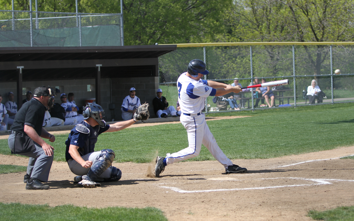 DCTC Catcher Briar Braulick getting hit against DMACC at Alimagnet Park