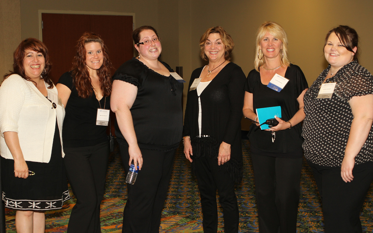 (left to right) Rose Lindquist, Brittany Scott, Cara Tuenge, Nancy Rotramel, Dawn Nelson, Katie Johnson working at DCTC 2011 Commencement at Treasure Island