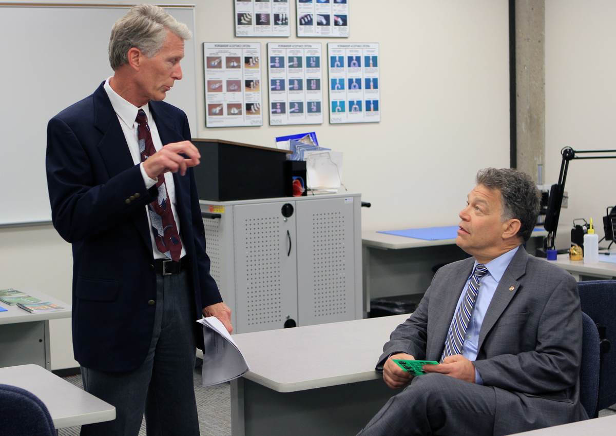 DCTC Director of Manufacturing and Railroad Larry Raddatz with Senator Franken in CT soldering classroom