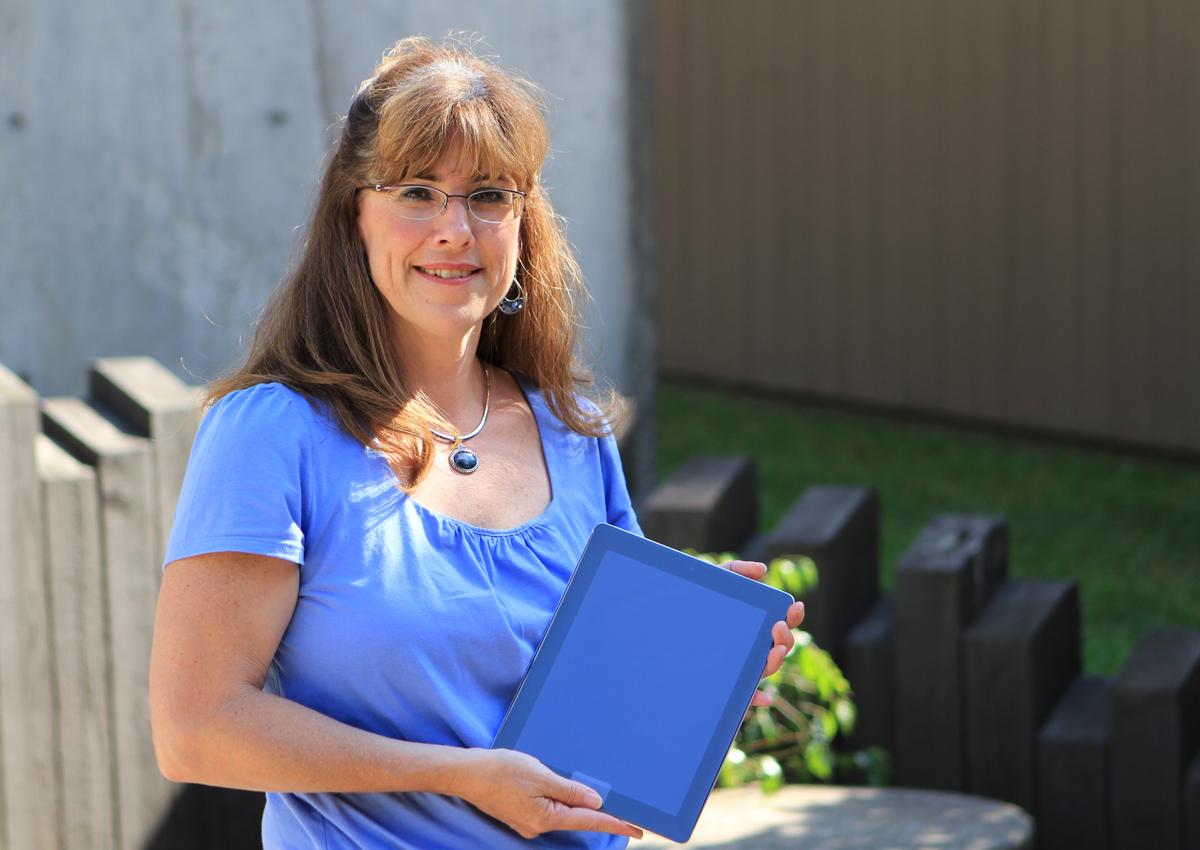 Renee Belland-Wenda with her new iPad 2