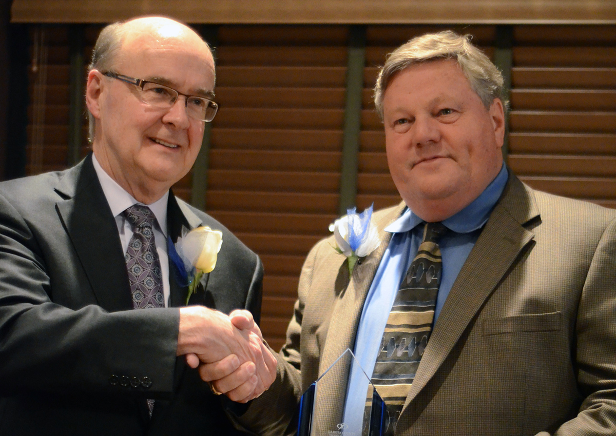 SKB Vice President Rick O'Gara accepts DCTC Advocacy award from DCTC President Ron Thomas