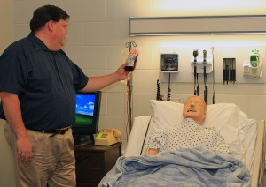 Reeves with SimMan patient simulator