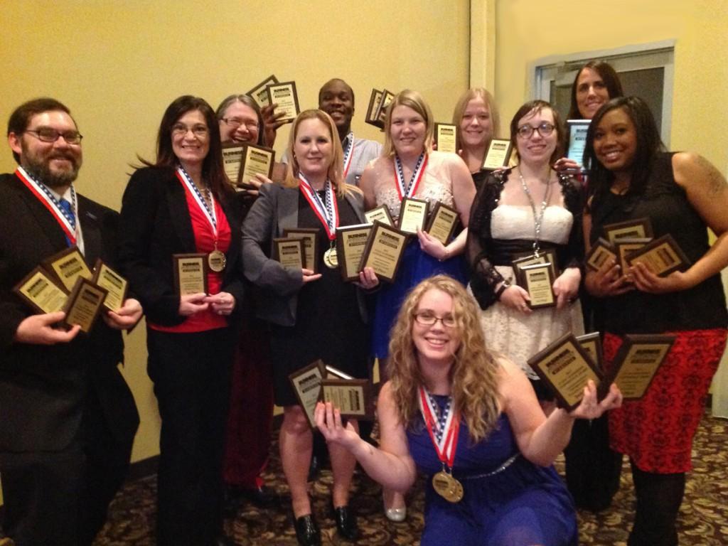 Group holding up awards