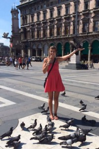 Lindsay in Milan, Italy, making friends with a local pigeon
