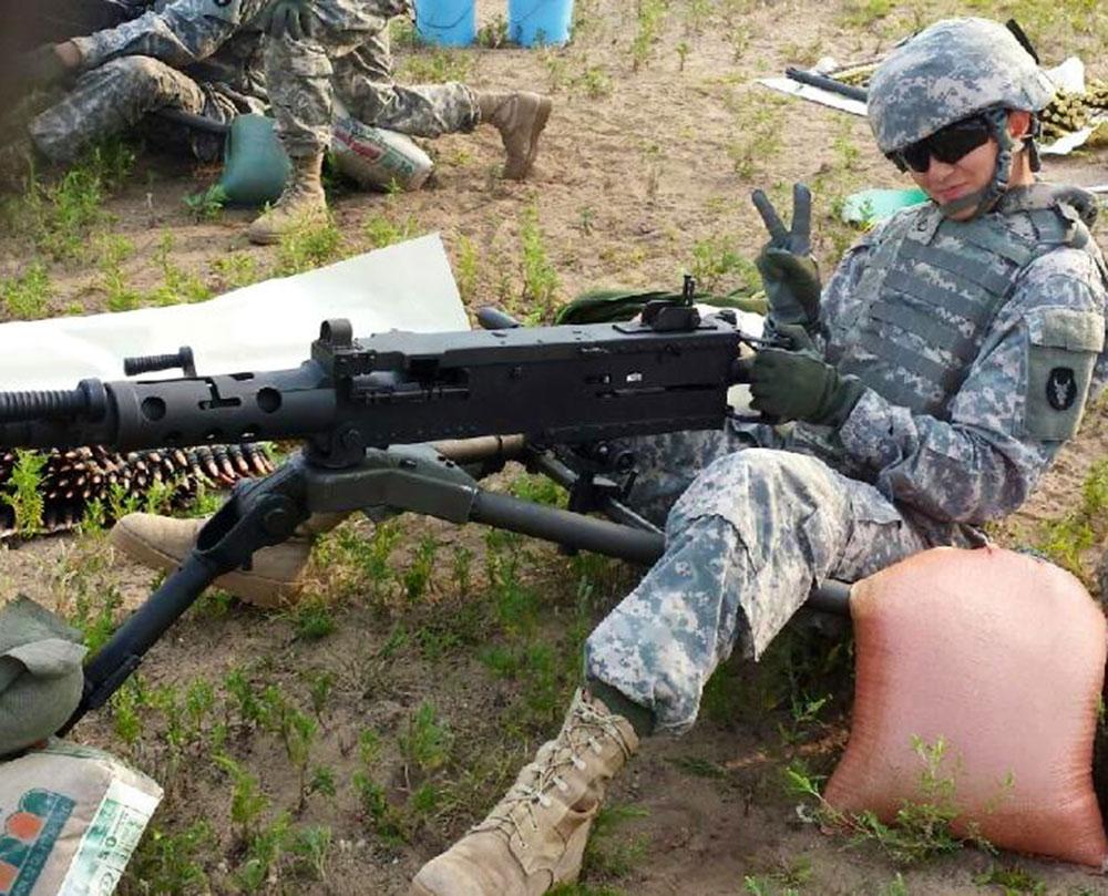 Lindsay firing a 50-caliber machine gun during basic training