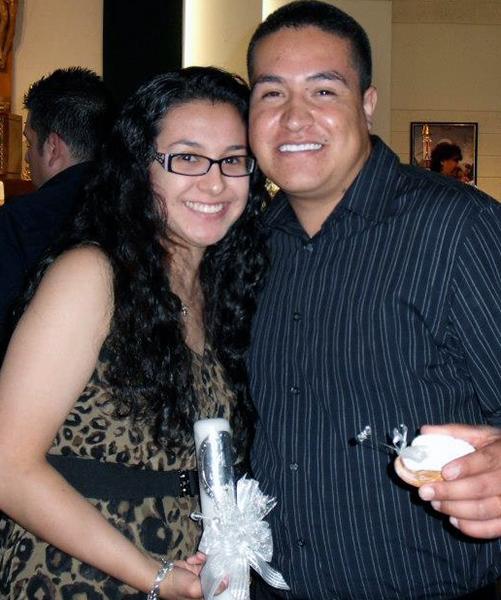 Marisela and husband Rodrigo at a baptism