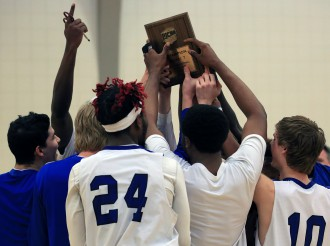 The Blue Knights hold up their championship trophy after beating Southeast Community College March 6.