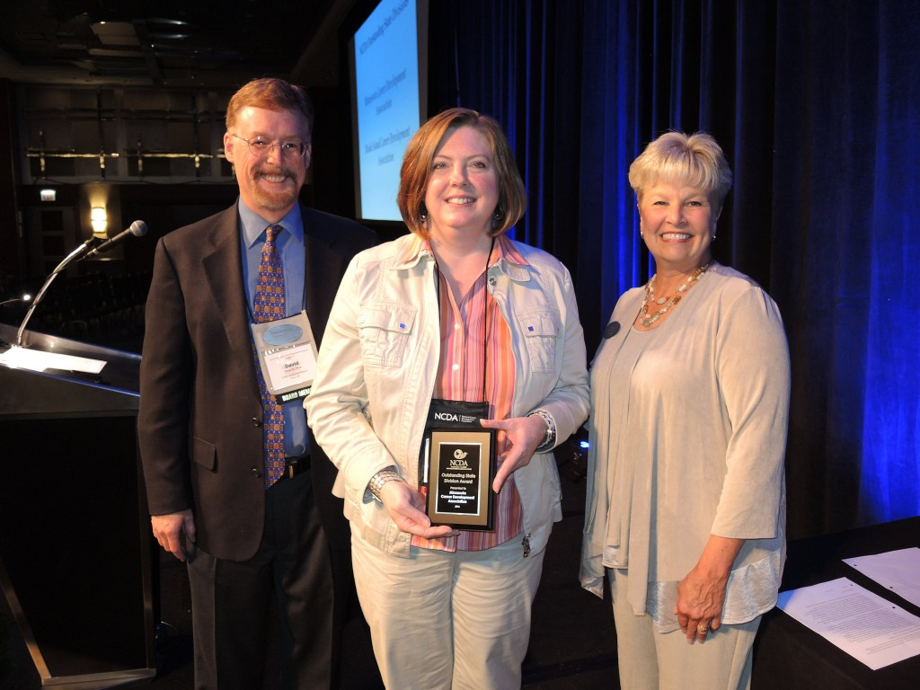 DCTC's Career Services director Jessica Ayub stand with NCDA President-elect David Reile and outgoing President Cynthia Marco-Scalon.