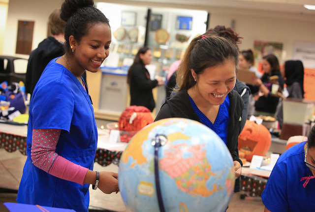Medical assisting students walk through and decide which pumpkins are their favorite