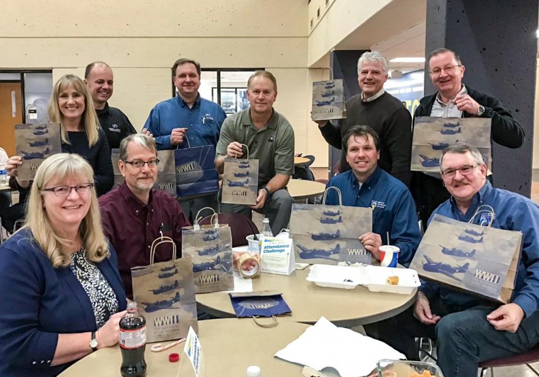 (left to right) Patricia Weigand, Marie Saunders, Joel Fogarty, Tim McCluskey, Roger Gartner, Mark Hickman, Mark Brantner, Lyle Stelter, Steve Helmueller,Ed Norton