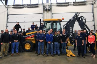 HCET students and faculty with brand-new John Deere backhoe loader from RDO