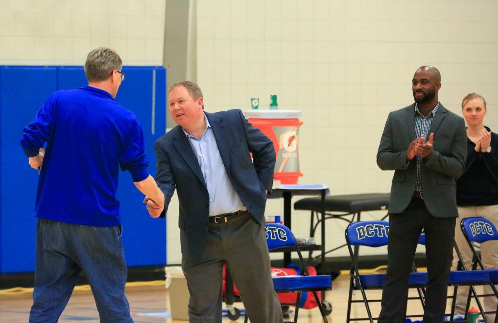DCTC President Tim Wynes congratulating Coach Boe on NJCAA DII Region 13 Championship