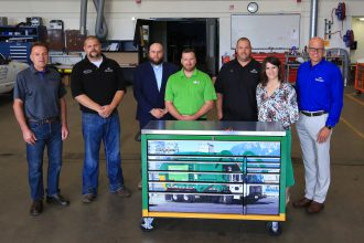 (left to right) Ken Klassen, HDTT faculty, Brent Newville, HDTT faculty, Scott Determan, dean of transportation, construction & manufacturing, Tim Gerten, Waste Management senior district fleet manager, Pete Szybatka, HDTT faculty, Michelle Boe, executive director of foundation, Mike Opp, vice president of academic and student affairs