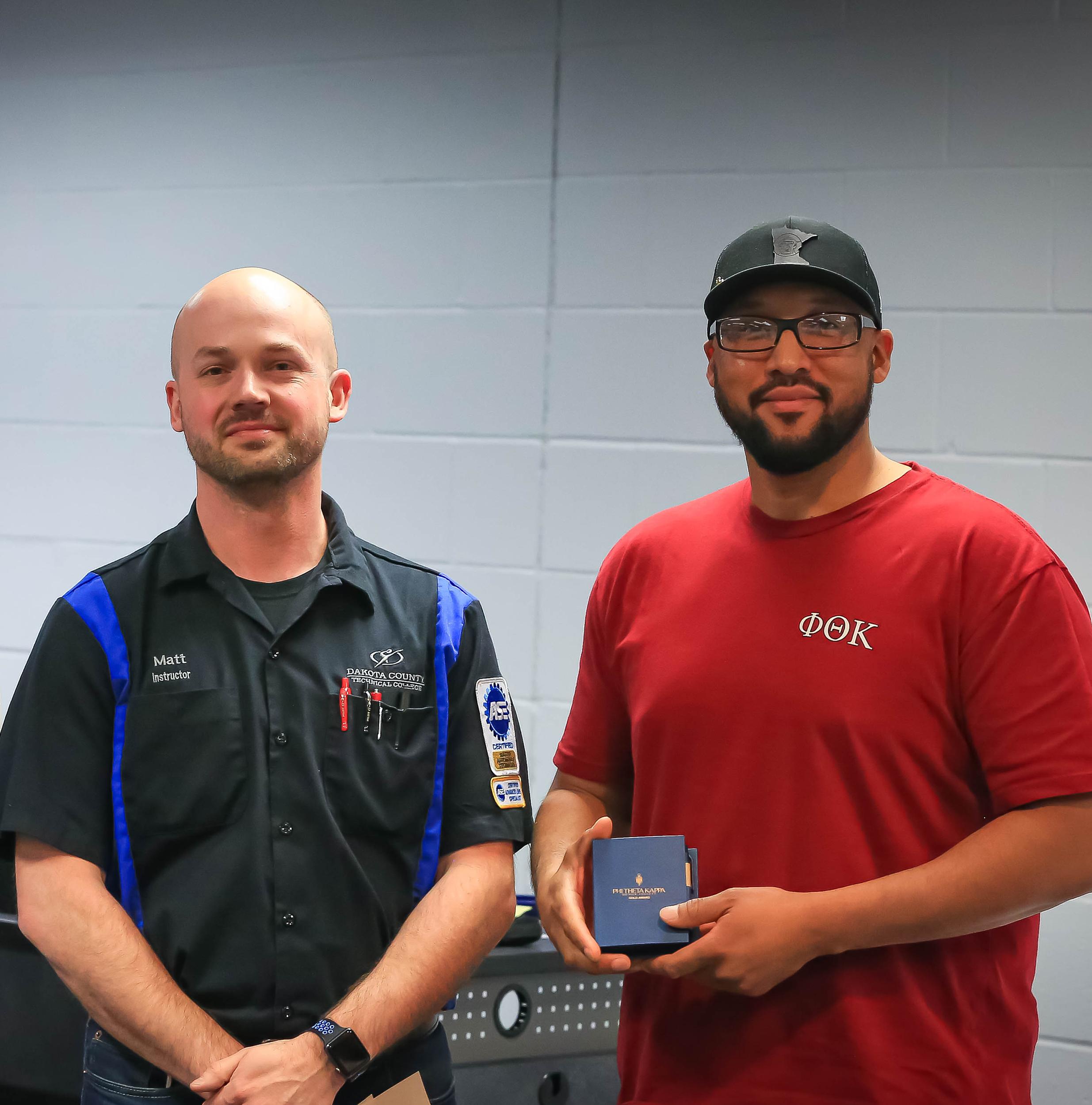 (left) Automotive Tech Student Brandon Folson with Instructor Matt Boudinot